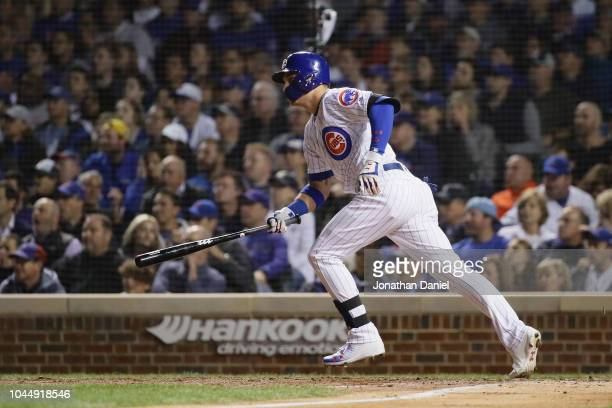 Albert Almora Jr #5 of the Chicago Cubs hits a single in the seventh inning against the Colorado Rockies during the National League Wild Card Game at...