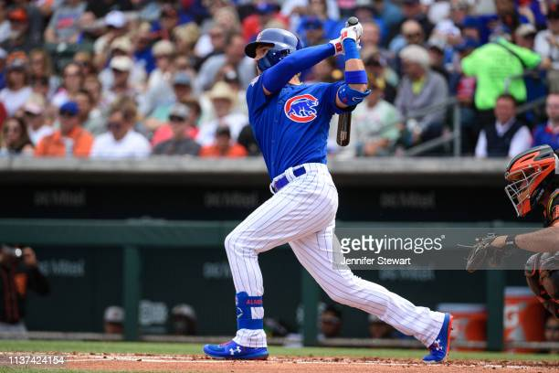Albert Almora Jr #5 of the Chicago Cubs hits a solo home run in the first inning of the spring training game against the San Francisco Giants at...