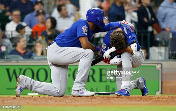Albert Almora Jr #5 of the Chicago Cubs is comforted by Jason Heyward after a young child was injured by a foul ball off his bat in the fourth inning...