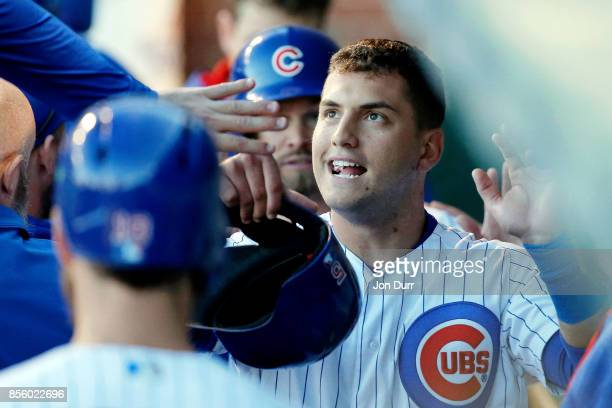 Albert Almora Jr #5 of the Chicago Cubs is congratulated in the dugout after scoring against the Cincinnati Reds on an RBI single hit by Rene Rivera...