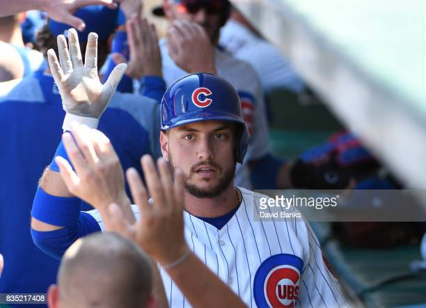 Albert Almora Jr #5 of the Chicago Cubs is greeted by his teammates after scoring against the Toronto Blue Jays during the fifth inning on August 18...