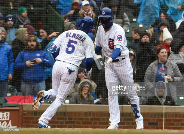 Albert Almora Jr #5 of the Chicago Cubs is greeted by Kris Bryant of the Chicago Cubs after hitting a home run against the Atlanta Braves during the...