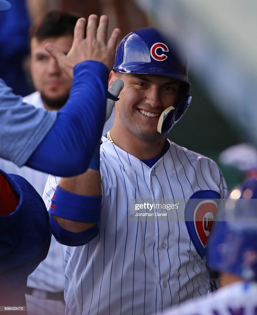 Albert Almora Jr. #5 of the Chicago Cubs is greeted in the dugout after hitting a solo home run in the 9th inning against the Cincinnati Reds at Wrigley Field on October 1, 2017 in Chicago, Illinois. The Reds defeated the Cubs 3-1.