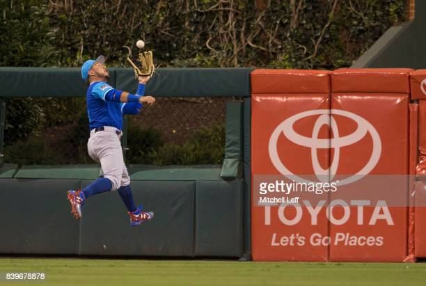 Albert Almora Jr #5 of the Chicago Cubs makes a running catch on a ball hit by Tommy Joseph of the Philadelphia Phillies in the bottom of the fourth...