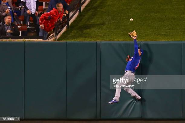 Albert Almora Jr #5 of the Chicago Cubs prevents a home run at the wall against the St Louis Cardinals in the seventh inning at Busch Stadium on...