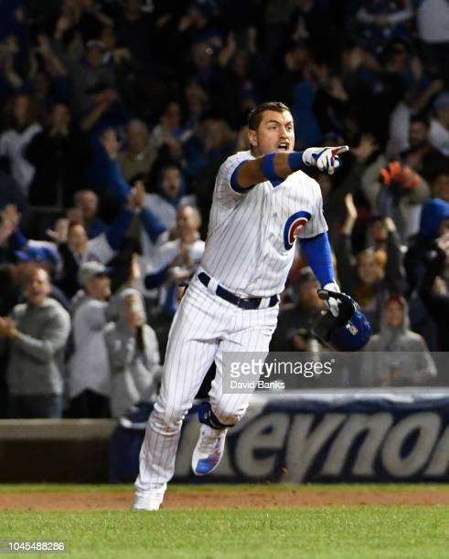 Albert Almora Jr #5 of the Chicago Cubs reacts after hitting a gamewinning walkoff single against the Pittsburgh Pirates during the tenth inning on...