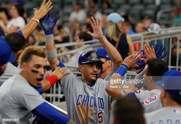Albert Almora Jr #5 of the Chicago Cubs reacts after scoring on a RBI double hit by Addison Russell in the ninth inning against the Atlanta Braves at...