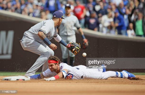 Albert Almora Jr. #5 of the Chicago Cubs slides in to second base with a double ahead of the throw to Hernan Perez of the Milwaukee Brewers in the...