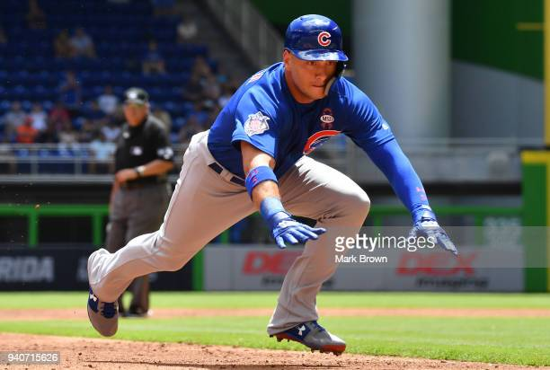 Albert Almora Jr #5 of the Chicago Cubs slides into third base in the third inning against the Miami Marlins at Marlins Park on April 1 2018 in Miami...