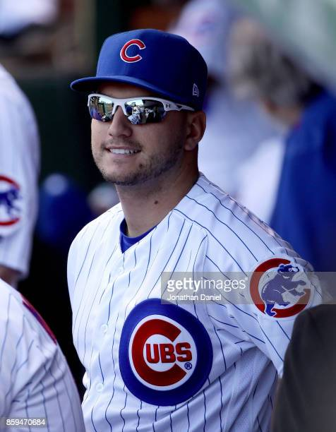 Albert Almora Jr #5 of the Chicago Cubs stands in the dugout before game three of the National League Division Series against the Washington...