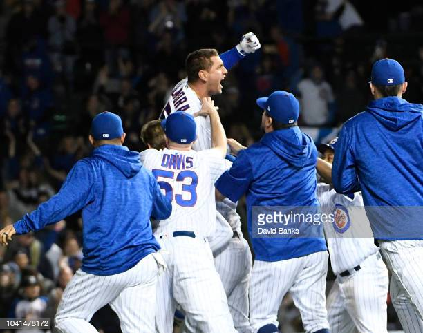 Albert Almora Jr of the Chicago Cubs celebrates his gamewinning walkoff single against the Pittsburgh Pirates during the tenth inning on September 26...