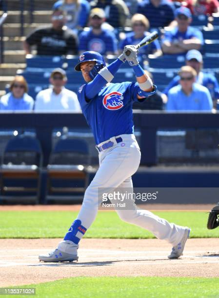 Albert Almora Jr of the Chicago Cubs follows through on a swing during a spring training game against the Milwaukee Brewers at Maryvale Baseball Park...