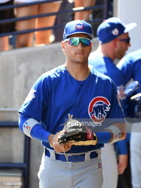 Albert Almora Jr of the Chicago Cubs follows walks through the dugout prior to a spring training game against the Milwaukee Brewers at Maryvale...