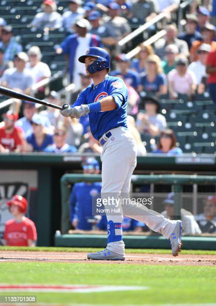 Albert Almora Jr of the Chicago Cubs hits a solo home run during the first inning against the Cincinnati Reds during a spring training game at...