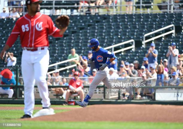 Albert Almora Jr of the Chicago Cubs rounds the bases after hitting a solo home run during the first inning off of Tony Santillan of the Cincinnati...
