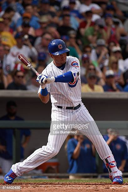 Albert Almora of the Chicago Cubs hits a double in the third inning against the Cincinnati Reds on March 5 2016 in Mesa Arizona