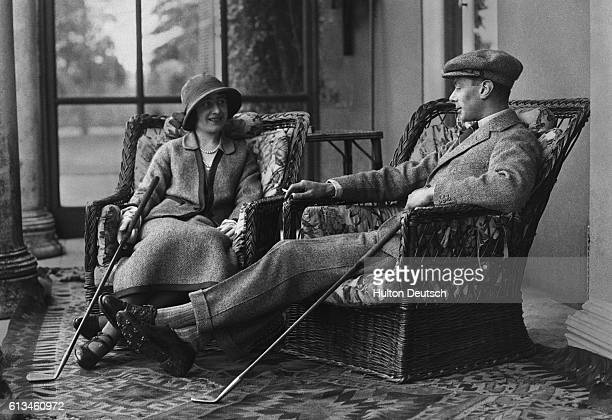 Albert and Elizabeth Duke and Duchess of York relax after a round of golf during their honeymoon They are the future King George VI and Queen...