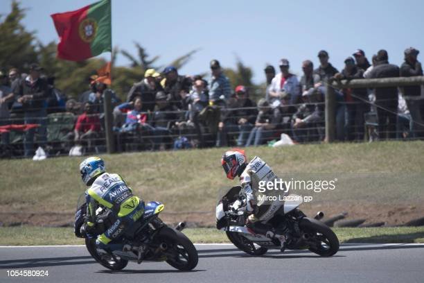 Albert Arenas of Spain and Angel Nieto Team Moto3 celebrates the victory with Vicent Perez of Spain and Reale Avintia Academy 77 at the end of the...