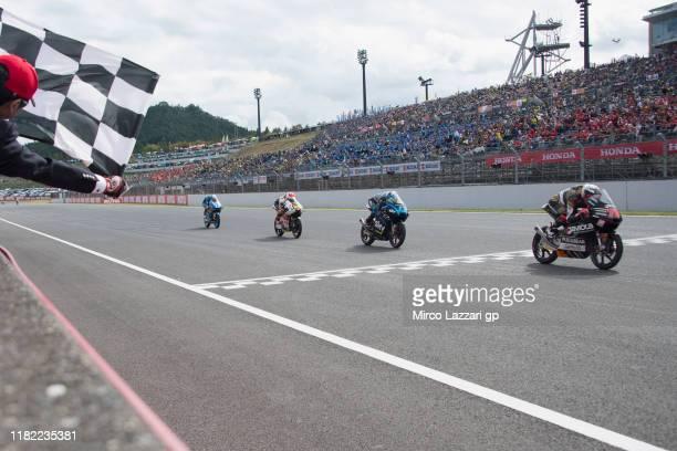Albert Arenas of Spain and Sama Qatar Angel Nieto Team cuts the finish lane in front of Celestino Vietti Ramus of Italy and Sky Racing Team VR46...