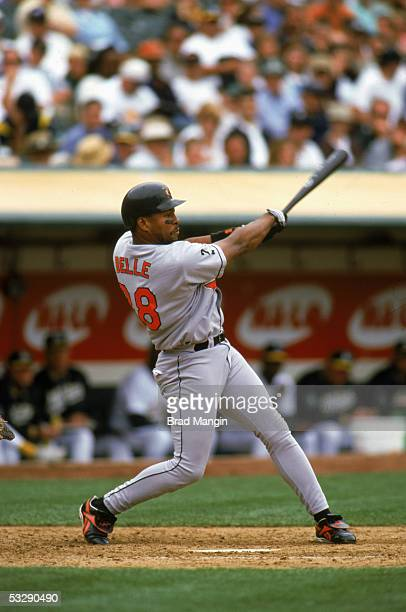 Albert Belle of the Baltimore Orioles bats during an MLB game at Network Coliseum in Oakland California