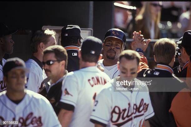 Albert Belle of the Baltimore Orioles celebrates a home run during a baseball game against the Toronto Blue Jays on April 11 1999 at Camden Yards in...