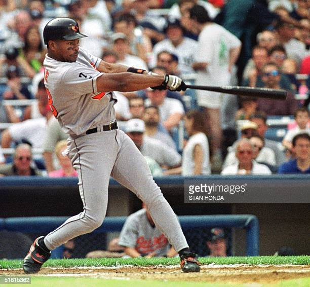 Albert Belle of the Baltimore Orioles hits a solo home run in the fourth inning off New York Yankee pitcher Orlando Hernandez in game at Yankee...