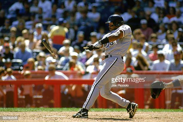 Albert Belle of the Chicago White Sox breaks his bat on a pitch during an MLB game on June 1 1997 at Milwaukee County Stadium in Milwaukee Wisconsin
