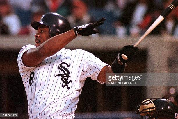 Albert Belle of the Chicago White Sox hits a single in the third inning of Chicago's game against the Baltimore Orioles 06 June at Comiskey Park in...