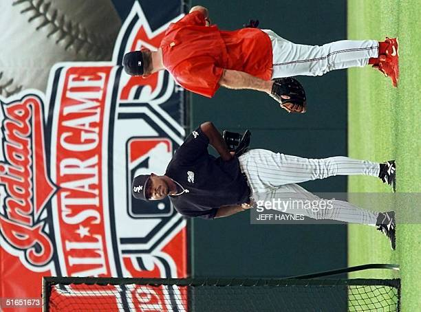 Albert Belle of the Chicago White Sox talks to former teammate Jim Thome of the Cleveland Indians 08 July during warmups for the Major League AllStar...
