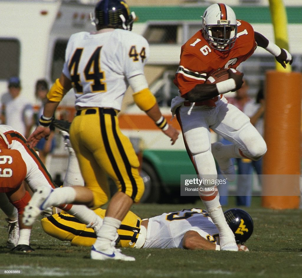 Albert Bentley Of The Miami Hurricanes Carries The Ball