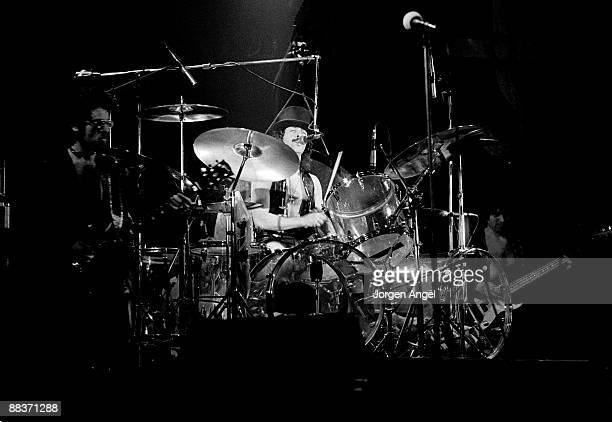 Albert Bouchard of the band Blue Oyster Cult performs on stage playing transparent drum kit on October 27th 1975 in Copenhagen Denmark