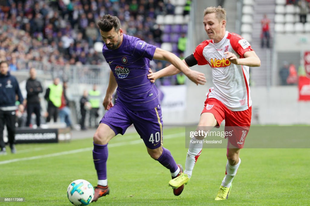 Albert Bunjaku of Aue is challenged by Marc Lais of Regensburg during the Second Bundesliga match between FC Erzgebirge Aue and SSV Jahn Regensburg at Sparkassen-Erzgebirgsstadion on October 22, 2017 in Aue, Germany.