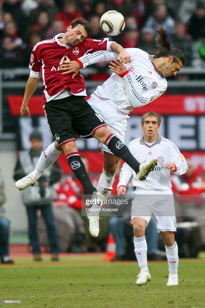 Albert Bunjaku of Nuernberg and Martin Demichelis of Bayern jump for a header during the Bundesliga match between 1. FC Nuernberg and FC Bayern Muenchen at Easy Credit Stadium on February 20, 2010 in Nuremberg, Germany.