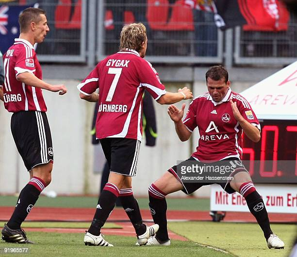Albert Bunjaku of Nuremberg celebrates scoring his team's second goal with his team mates Daniel Gygax and Marek Mintal during the Bundesliga match...