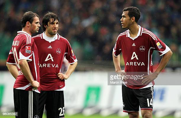 Albert Bunjaku Thomas Broich and Eric Maxim Choupo Moting of Nuernberg look dejected after the Bundesliga match between Werder Bremen and 1 FC...