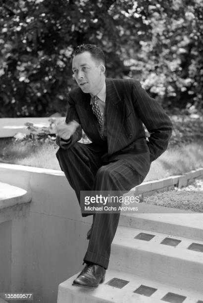 Albert Camus in the garden of his Paris studio 1952