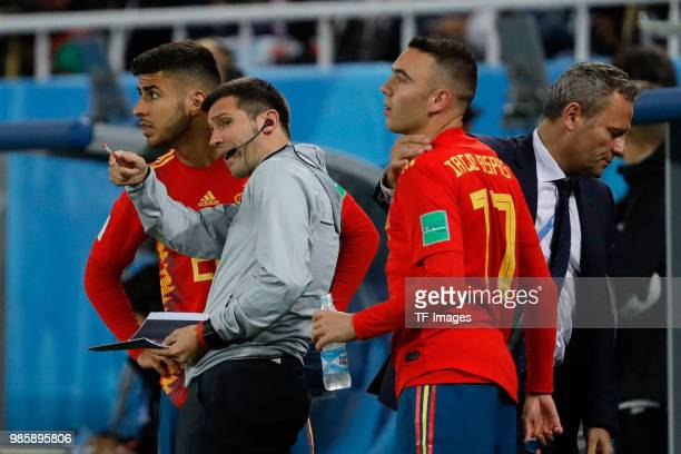 Albert Celades speaks with Marco Asensio of Spain and Iago Aspas of Spain during the 2018 FIFA World Cup Russia group B match between Spain and...