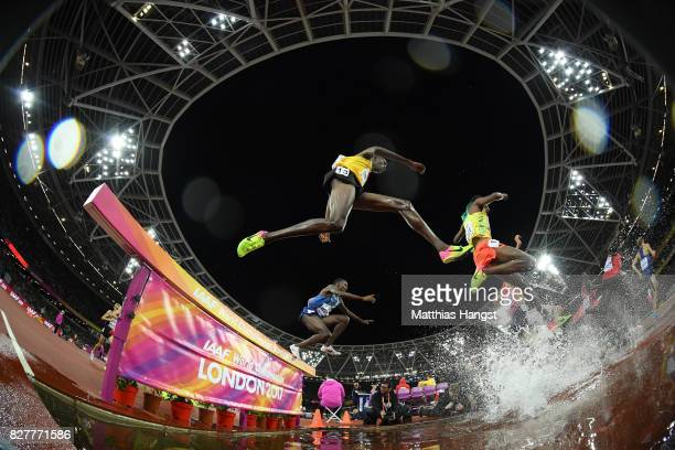 Albert Chemutai of Uganda and Stanley Kipkoech Kebenei of the United States compete in the Men's 3000 metres Steeplechase final during day five of...