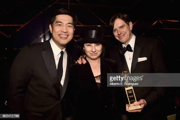 Albert Cheng writer/producers Daniel Palladino and Amy ShermanPalladino attends Amazon Studios' Golden Globes Celebration at The Beverly Hilton Hotel...