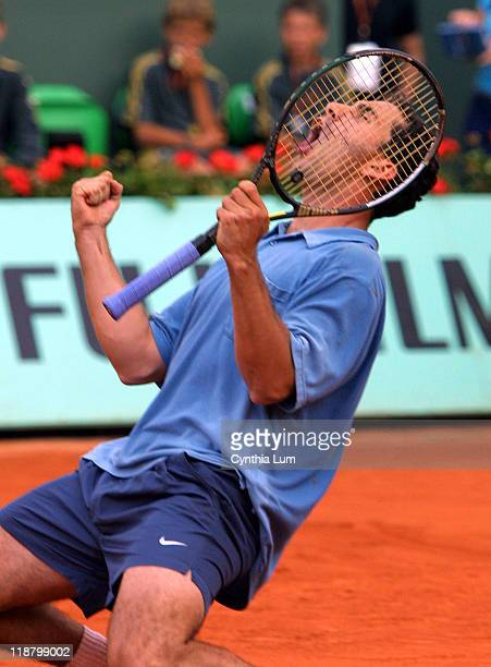Albert Costa celebrates his 6-4, 7-5, 6-4 victory over Gustavo Kuerten in their fourth-round match at the 2002 French Open.