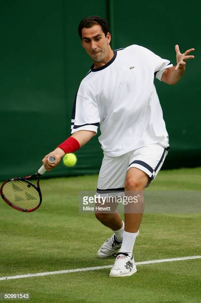 Albert Costa of Spain in action during his first round match against Mark Hilton of Great Britain at the Wimbledon Lawn Tennis Championship on June...
