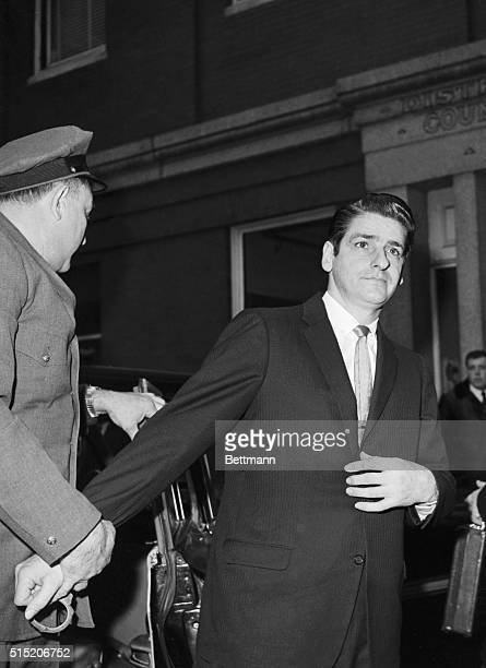 Albert De Salvo who claims to be the Boston Strangler is escorted into Cambridge Superior Court where will stand trial on charges of armed robbery...