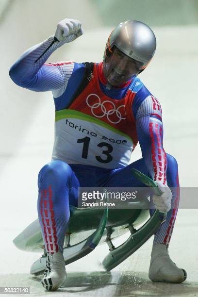 Albert Demtschenko of Russia celebrates his final Silver Medal winning run in the Mens Luge Single Final on Day 2 of the 2006 Turin Winter Olympic...