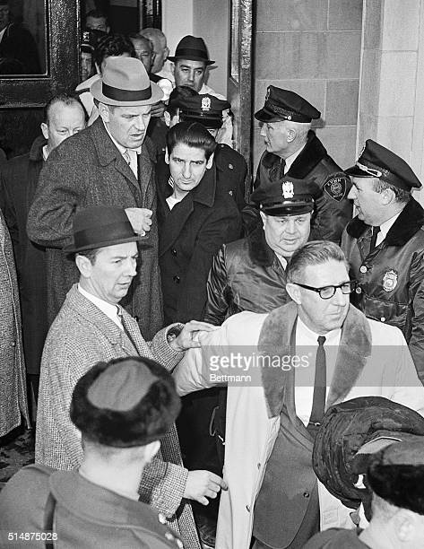 Albert DeSalvo the Boston Strangler is escorted out of Lynn Police Station to be taken to Walpole State Prison He was captured in a West Lynn uniform...