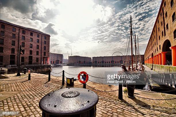 albert dock against cloudy sky on sunny day - liverpool england stock pictures, royalty-free photos & images