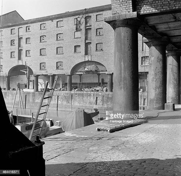 Albert Dock Liverpool Merseyside 1956 The upper stories of the warehouses in Albert Dock are carried forward to the quayside on columns to improve...
