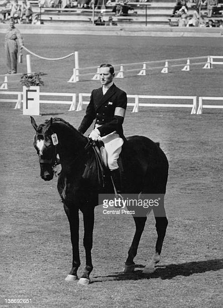 Albert Edwin Hill on Countryman, greeting Queen Elizabeth II at the Olympic Stadium in Stockholm, during the Summer Olympics, 12th June 1956. The...