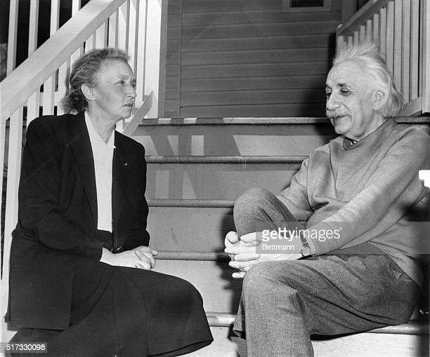 Albert Einstein and Mme Irene JoliotCurie French nuclear physicist sit in the sun on the back porch of Einstein's home in Princeton New Jersey USA...