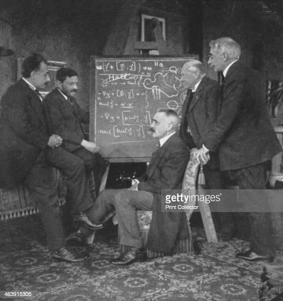 Albert Einstein and other physicists at Paul Ehrenfest's home, Leiden, Netherlands, circa 1915. Einstein with Paul Ehrenfest, Paul Langevin ,...