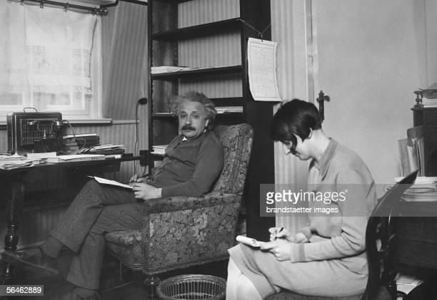 Albert Einstein dictating something to his secretary Germany Photography Around 1930 [Albert Einstein deutscher Physiker diktiert seiner Sekretaerin...